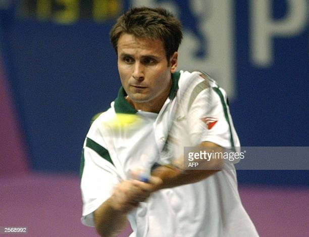French Fabrice Santoro hits a backhand to his Russian opponent Marat Safin during their Lyon's ATP tournament 07 October 2003 at the Sport Palace in...