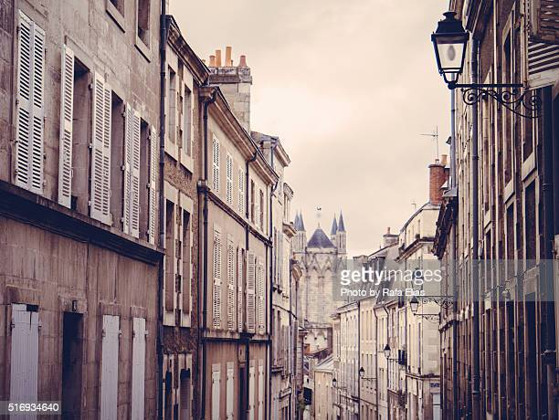 french facades in street - ポワティエ ストックフォトと画像