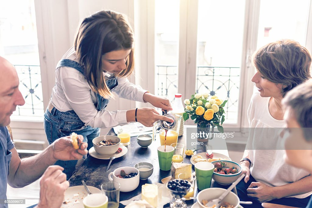 french family having breakfast together in appartment : Stock-Foto
