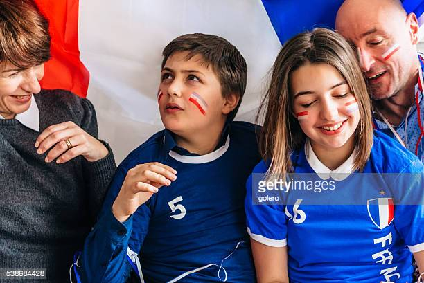 french family soccer fans with french flag and sports uniform