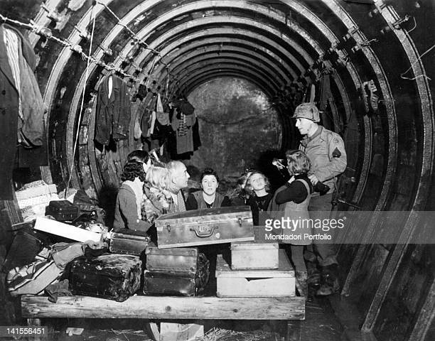 A French family taking refuge in an underground section of the Maginot Line controlled by US Army troops Lorraine December 1944
