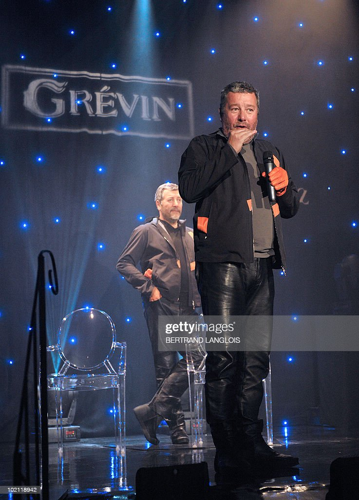 French famous designer Philippe Starck poses in front of his wax likeness at the Grevin wax museum in Paris, on June 15, 2010, during the presentation of his effigy. Starck is the first architect and designer to enter the Grevin.