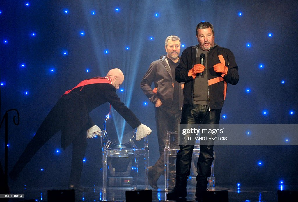 French famous designer Philippe Starck poses next to his wax likeness at the Grevin wax museum in Paris, on June 15, 2010, during the presentation of his effigy. Starck is the first architect and designer to enter the Grevin.