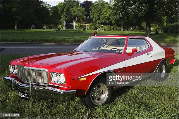 French fan David Danan rides in Starsky and Hutch's legendary 'Red Tomato' in Paris France on May 07 2004