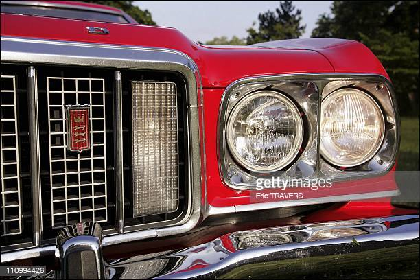 French fan David Danan rides in Starsky and Hutch's legendary 'Red Tomato' in Neuilly sur Seine France on May 01 2004
