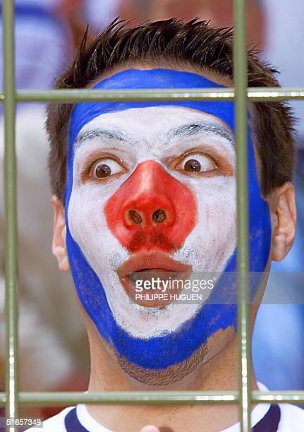 French fan makes a face before the 1998 Soccer World Cup second round match between France and Paraguay 28 June at the Felix Bollaert stadium in Lens...