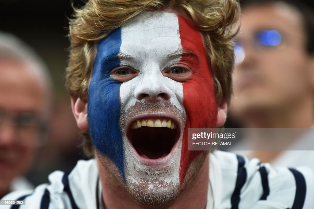 A French fan reacts during the Russia 2018 World Cup Group C football match between France and Peru at the Ekaterinburg Arena in Ekaterinburg on June 21, 2018. (Photo by Hector RETAMAL / AFP) / RESTRICTED