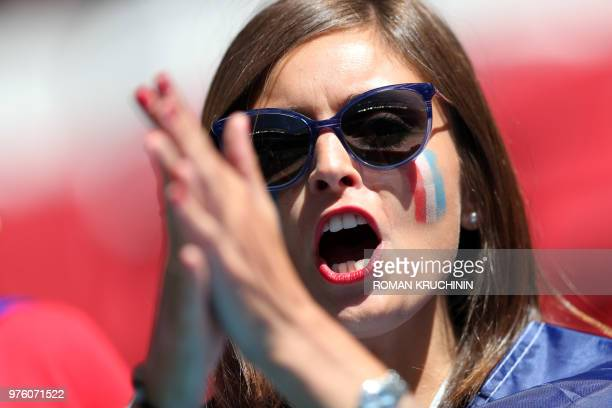 A French fan shouts before the Russia 2018 World Cup Group C football match between France and Australia at the Kazan Arena in Kazan on June 16 2018...