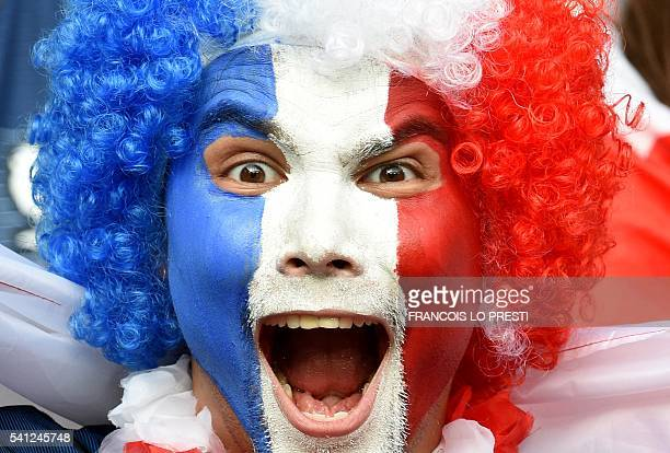 French fan waits for the start of the Euro 2016 group A football match between Switzerland and France at the Pierre-Mauroy stadium in Lille on June...