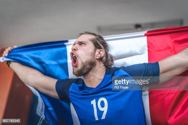 French fan watching a soccer game