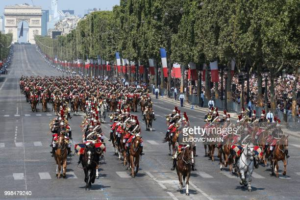 French Fanfare Mounted Republican guards take part in the annual Bastille Day military parade on the ChampsElysees avenue as the Arch of Triumph in...