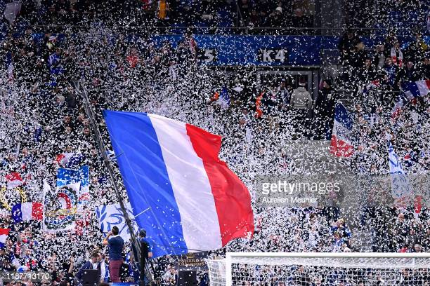 French fans are waving flags during the UEFA Euro 2020 Qualifier between France and Moldova on November 14 2019 in Paris France