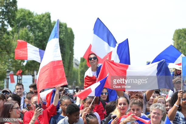 French Fans before the France team victory ceremony at Avenue Des Champs Elysees on July 16 2018 in Paris France France won the 2018 FIFA World Cup...