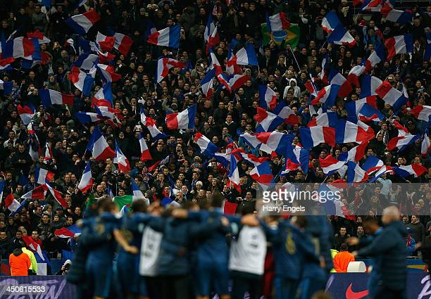 French fans celebrate after their side won the FIFA 2014 World Cup Qualifier 2nd Leg Playoff between France and Ukraine at the Stade de France on...