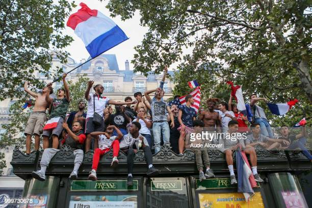 French fans celebrate the victory after the FIFA World cup final match between France and Croatia on July 15 2018 in Paris France