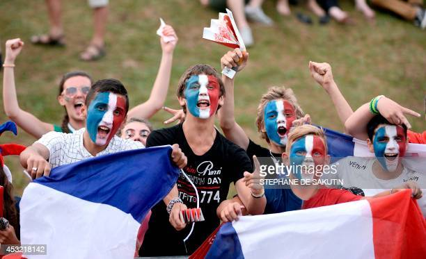 French fans cheer for their team before the 2014 Women's Rugby Union World Cup pool C match between France and South Africa in Marcoussis in the...