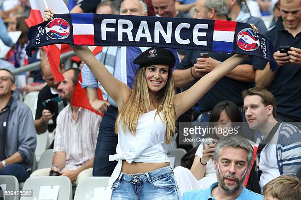 French fans cheer for their team during the UEFA Euro 2016 Group A opening match between France and Romania at Stade de France on June 10 2016 in...