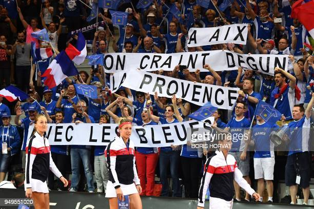 French fans cheer their team Kristina Mladenovic Pauline Parmentier and Amandine Hesse as they arrive for the Fed Cup semifinal match between France...
