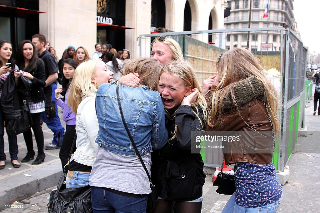 French fans crying after seeig Justin Bieber at Hotel de Sers on March 29, 2011 in Paris, France.