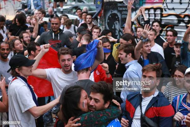 French fans erupt with joy, outside a local bar in the 20th arrondissement, as France wins its semi-final World Cup match against Belgium, on July...