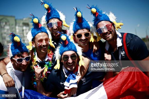 TOPSHOT French fans pose before the Russia 2018 World Cup Group C football match between France and Australia at the Kazan Arena in Kazan on June 16...