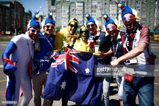 French fans pose with Australian ones before the Russia 2018 World Cup Group C football match between France and Australia at the Kazan Arena in...