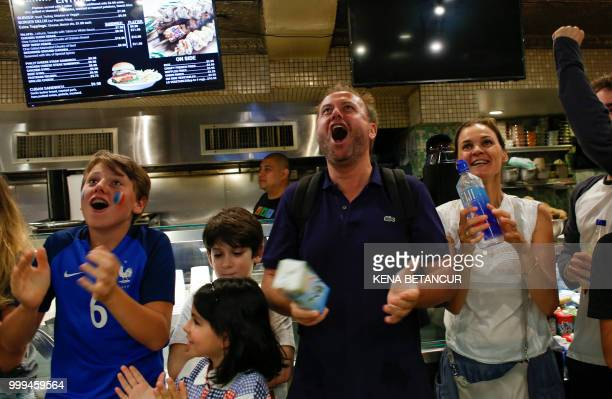 French fans react as France scores a goal as they watch the World Cup final match between France vs Croatia on July 15 2018 in New York The World Cup...