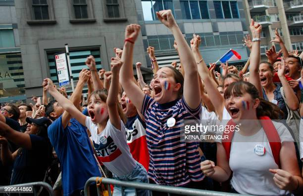 French fans react as France scores a goal while they watch the World Cup final match between France vs Croatia on July 15 2018 in New York The World...