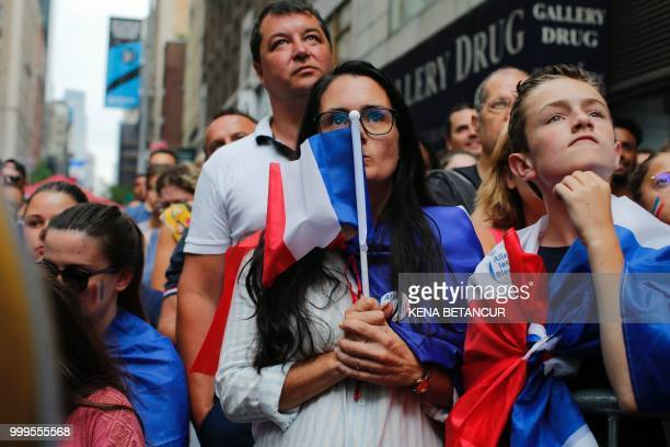 French fans react while they watch the World Cup final match between France vs Croatia on July 15 2018 in New York The World Cup final between France...