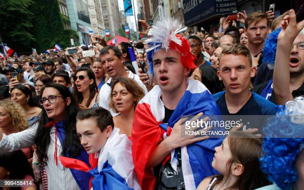 French fans sing the French National Anthem as they watch the World Cup final match between France vs Croatia on July 15 2018 in New York The World...