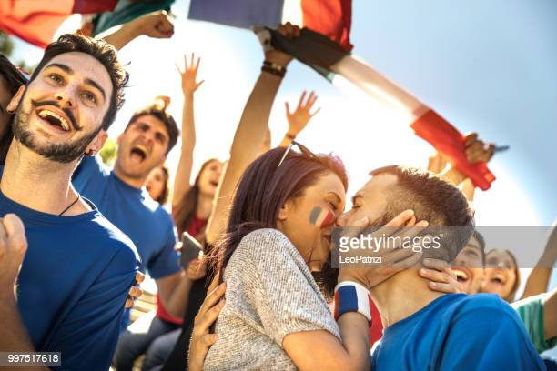 French fans watching and supporting their team at world competition football league