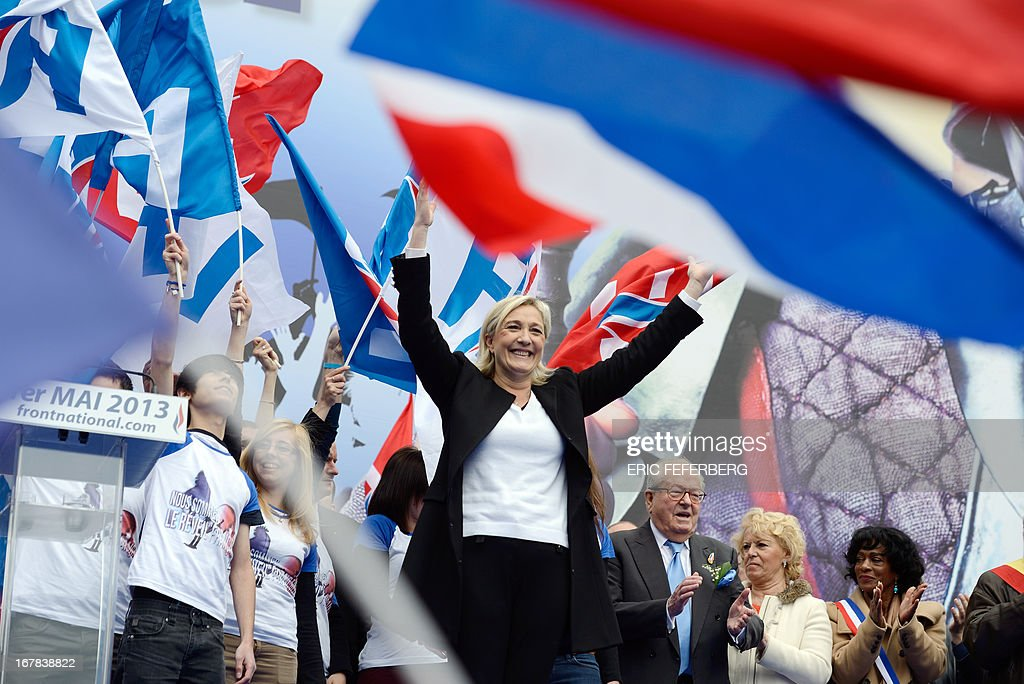 French far right Front National (FN) party president Marine waves to the crowd after her speech, during the party's annual celebrations of Joan of Arc on May 1, 2013 at Paris' Opera square.