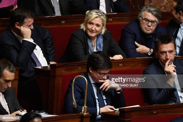 French far right party Front National deputies Louis Alliot Marine Le Pen and Gilbert Collard attend a session of questions to the government on...
