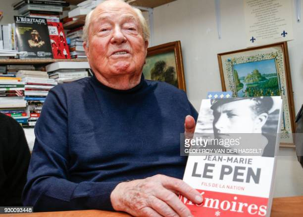 French far right party Front National honorary president JeanMarie Le Pen poses with his Memoires' first volume 'Fils de la Nation' during a book...