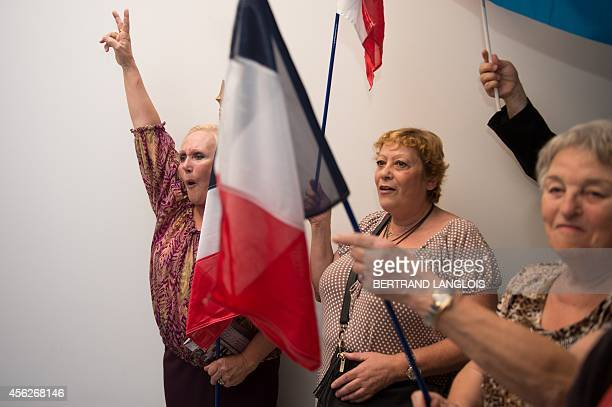 French far right party Front National new senator Stephane Ravier's supporters celebrate on September 28 2014 in Marseille southern France after the...