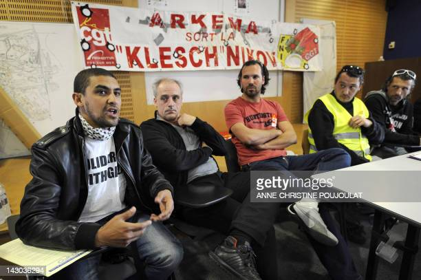 French farleft anticapitalist NPA party's candidate for 2012 French presidential election Philippe Poutou speaks with workers of Arkema Lavera...