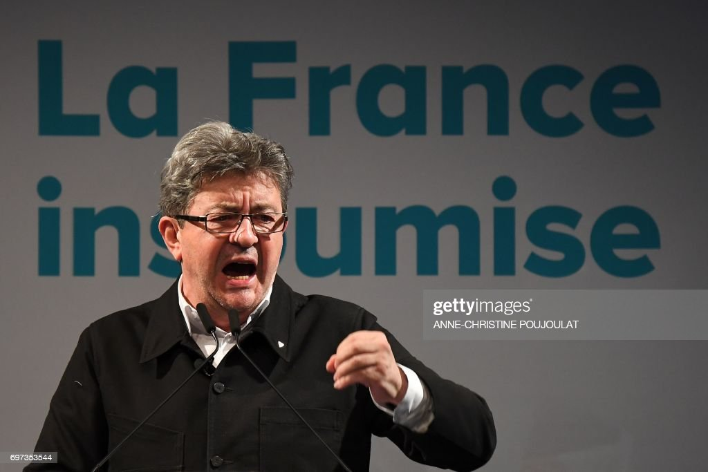 French far-left coalition La France Insoumise (LFI) leader Jean-Luc Melenchon gestures as he delivers a speech after the polls closed during the second round of the French parliamentary elections (elections legislatives in French) on June 18, 2017 in Marseille, southern France. Melenchon announces the creation of a future LFI Group at the French Assembly after beeing elected in the Bouches-du-Rhone following the results of the French parliamentary elections. President Emmanuel Macron's centrist party won a massive majority in parliamentary elections on June 18, 2017 early projections showed, dominating the country's traditional forces in a dramatic re-drawing of the political map. / AFP PHOTO / Anne-Christine POUJOULAT