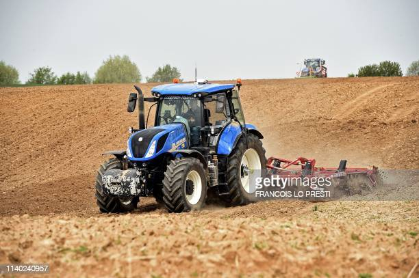 French farmer Alain Dequeker drives his tractor in his potatoes field hit by drought in AvesnesleSec near Bermerain northern France on April 23 2019