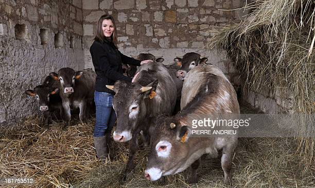 French farmer Berenice Walton poses with cows on February 14 in Arveyres near Bordeaux southwestern France The young breeder chooses meat labelling...