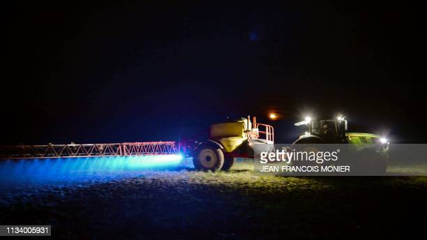 TOPSHOT French farmer Fabien Denis sprays glyphosate herbicide made by the Monsanto agrochemical giant roundup to prepare a cornfield to be sowed on...