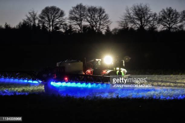 French farmer Fabien Denis sprays glyphosate herbicide made by the Monsanto agrochemical giant roundup to prepare a cornfield to be sowed on March 21...