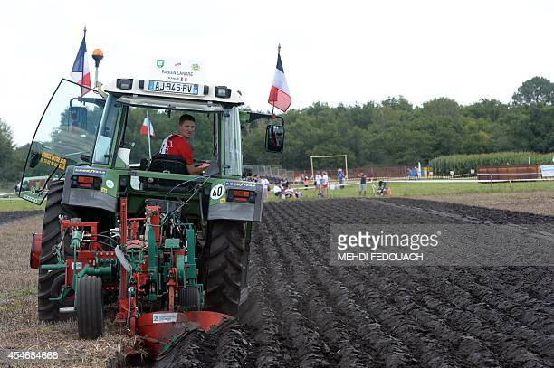 French farmer Fabien Landre competes on September 5 2014 in SaintJeand'Illac during the 61st National Ploughing Finals as part of the Les Terres de...