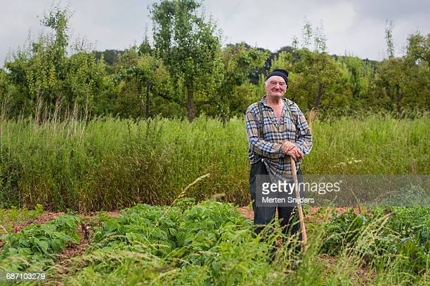 French farmer leaning on spade