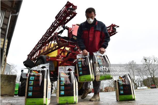 French farmer Nicolas Denieul gets ready to fill his agricultural sprayer with roundup a glyphosate based herbicide made by agrochemical giant...