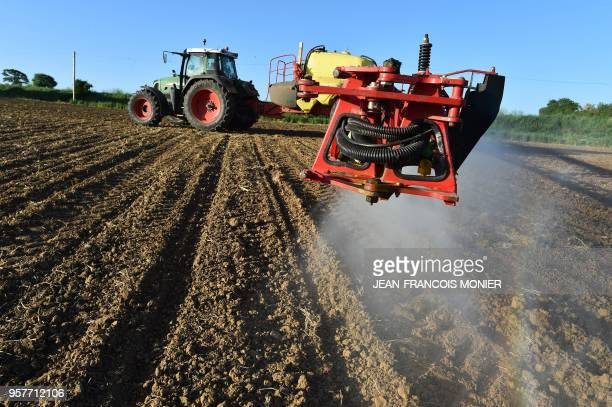 French farmer Nicolas Denieul pulverizes a glyphosate herbicide made by agrochemical giant Monsanto in Piace northwestern France in a field of notill...
