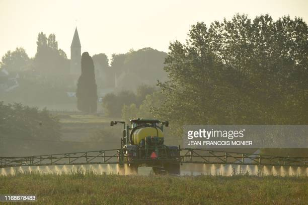A French farmer sprays glyphosate herbicide Roundup 720 made by agrochemical giant Monsanto at the rate of 720 grams per hectare in Saint GermainSur...