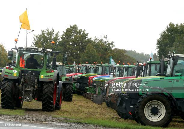 French farmers block the road with tractors in Laon northern France on October 8 during a demonstration called by FNSEA and JA farmers unions against...