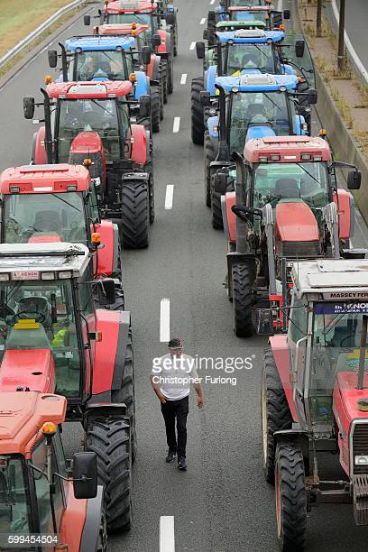 French farmers, blockade the main A16 motorway into the Channel Tunnel terminal protesting against the Jungle migrant camp on September 5, 2016 in...