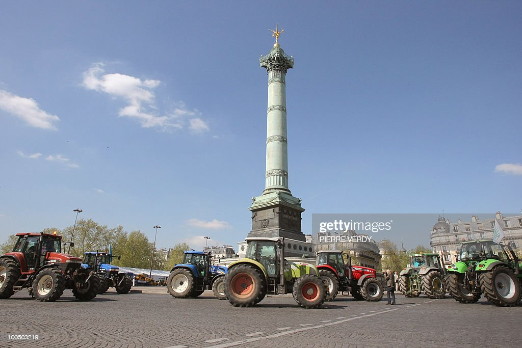 French farmers drive their tractors around the place de la Bastille in Paris on April 27, 2010 as they demonstrate against wages cut and to denounce the European Farm Policy. The demonstration headed by grain farmers was called by 14 regional unions and backed by the National Farmers union (FNSEA).