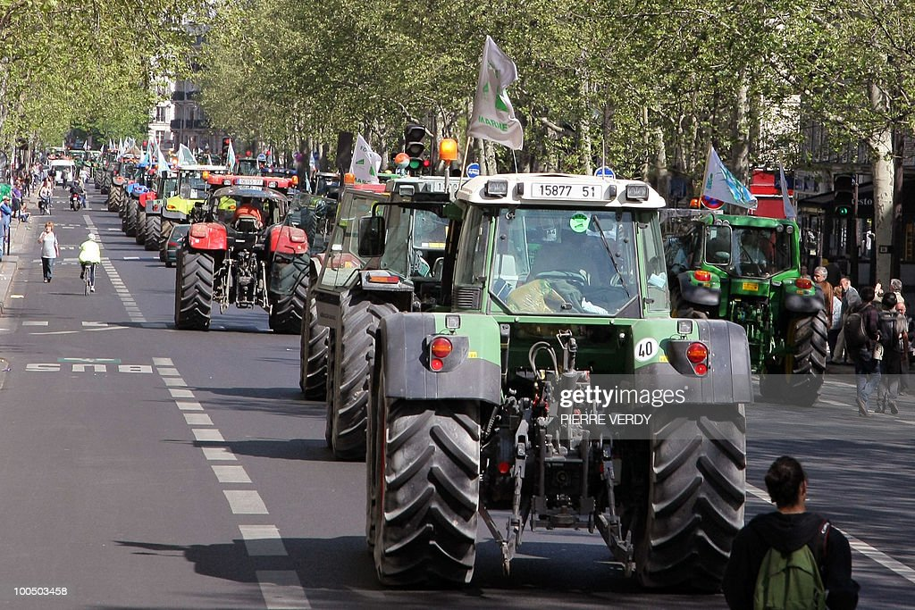 French farmers drive their tractors in Paris on April 27, 2010 as they demonstrate against wages cut and to denounce the European Farm Policy. The demonstration headed by grain farmers was called by 14 regional unions and backed by the National Farmers union (FNSEA).